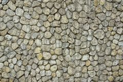 Stone Wall with Random Tiled Pattern Stock Photo