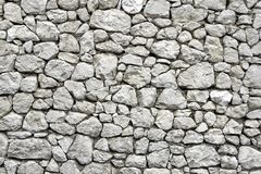 Stone Wall with Random Tiled Pattern Royalty Free Stock Images