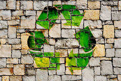 Stone wall with recycle symbol Royalty Free Stock Photo