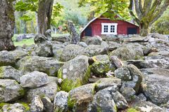 Stone wall with red barn Royalty Free Stock Image