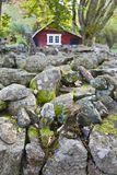 Stone wall with red barn Royalty Free Stock Images