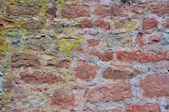 Stone wall. Red nature stone wall with gaps Stock Photo