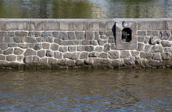 Stone wall in the river. Stone wall with boat berth royalty free stock images