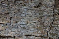 Stone wall of rock with cracks Royalty Free Stock Images