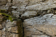 Stone wall of rock with cracks Royalty Free Stock Photography