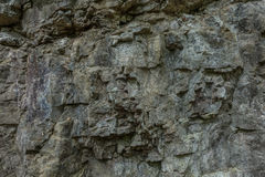 The stone wall of rock with cracks. The stone wall of a rock with cracks Stock Images