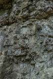The stone wall of rock with cracks. The stone wall of a rock with cracks Royalty Free Stock Photos