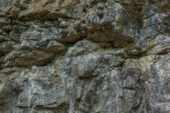 The stone wall of rock with cracks. The stone wall of a rock with cracks Royalty Free Stock Photography