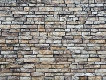 Stone wall of rough rectangular stones light beige color, abstract background. stock image