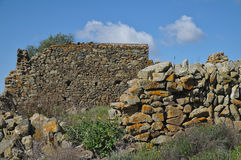 Stone wall ruins of an old and forgotten farm Stock Images