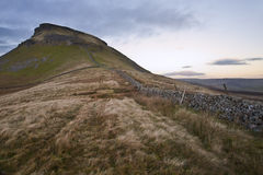 Stone wall running up height of Pen-y-Ghent in Yorkshire Dales  Stock Image