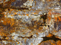 Stone wall with rust, grunge texture Stock Photography