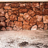 Stone wall and sand for background.  Stock Images