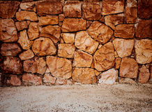 Stone wall and sand for background.  Royalty Free Stock Images