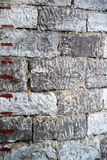 Stone wall with a scale. Near castle Royalty Free Stock Photo