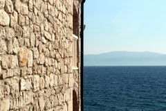 Stone wall and sea. Stone wall and adriatic sea Royalty Free Stock Images
