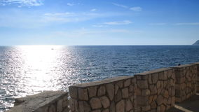 Stone wall by the sea stock footage
