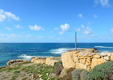 Stone wall by the sea Stock Photography