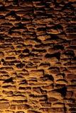 Stone wall with shadows. Stone wall texture at night stock photos
