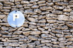 Stone wall and sign Royalty Free Stock Photo