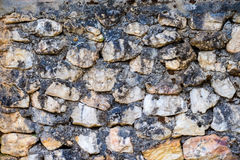 Stone wall. Small stones, as well as strong walls Stock Image