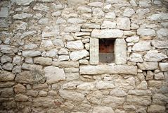 Stone wall with small window texture background Royalty Free Stock Photo