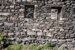 Stone wall with some windows Royalty Free Stock Photography