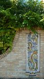 Stone wall with spanish ornament in garden stock photo