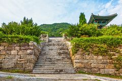 Stone wall with stairs to monk temple Stock Photos