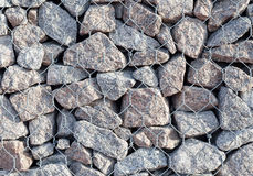 Stone wall in steel grating texture background. Stock Photography