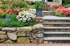 Stone Wall, Steps and Planter. Colorful, landscaped garden Royalty Free Stock Image