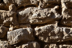 Stone wall. Wall of the stones in the side sunshine Royalty Free Stock Photos