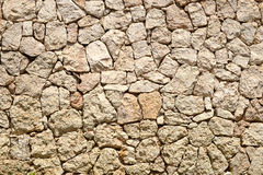 Stone Wall. Stonework of yellow sandstone . Features stone pattern Royalty Free Stock Image