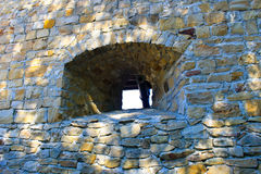 Stone wall of stronghold with embrasure. Stone wall of a stronghold with embrasure stock photos