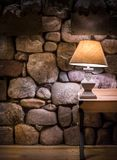 Stone wall and stylish lamp royalty free stock images
