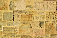 A stone wall sunlit Royalty Free Stock Photos
