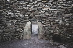 Stone wall texture and small door royalty free stock photos