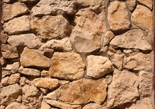 Stone wall texture. Closeup of aged stone wall texture Stock Images
