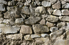 Stone wall texture. Ancient rough stone walling texture as background Stock Photos
