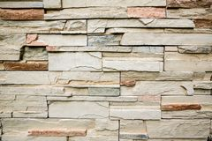 The stone wall texture background natural color.Background of stone wall texture photo.Natural stone wall texture for background. Old Brick texture, Grunge royalty free stock images