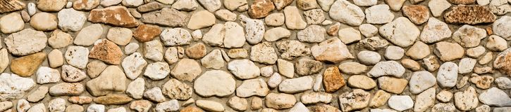 Stone wall texture background, panorama of masonry. Stone wall texture background, panorama of stone wall, masonry background royalty free stock image
