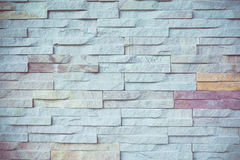 Stone wall texture background on vintage retro color tone Royalty Free Stock Images