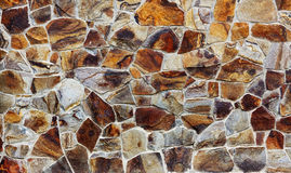 Stone wall texture. Built from colorful stones Stock Photography