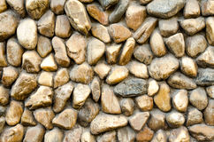 Stone wall  Texture of different forms stones similar to wall Stock Photos