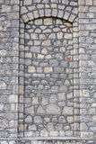 Stone wall texture door Royalty Free Stock Image