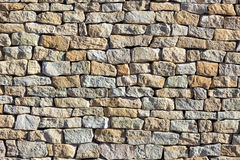 Stone wall texture lit by sun Royalty Free Stock Image