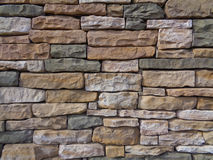 Stone Wall Texture. Stone wall with stone of many different sizes and textures royalty free stock image