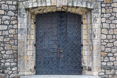 Stone wall texture with medieval door Royalty Free Stock Photo