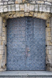 Stone wall texture with medieval door Stock Images