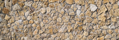 Stone wall texture. Old ancient detailed surface Stock Photos